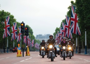 Sam Pelly riding the Boyarde bike customised Royal Enfield bike as part of Elephant family's 'Concours d'éléphant' parade down The Mall during the photocall in London. PRESS ASSOCIATION Photo. Picture date: Tuesday June 12, 2018. A customised fleet of 12 Ambassador cars, eight Royal Enfield motorbikes, a tuk tuk and a Gujarati Chagda made up the 'Concours d'éléphant' - a cavalcade of designer inspired, quintessentially Indian vehicles - while thirty beautifully decorated elephant sculptures will stand sentinel across the capital, ambassadors for their cousins in the wild. Photo credit should read: Steven Paston/PA Wire
