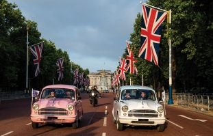 Elephant Family's 'Concours d'éléphant' made up of a customised fleet of Royal Enfield bikes, Ambassador cars and a tuk tuk parading down The Mall during the photocall in London. PRESS ASSOCIATION Photo. Picture date: Tuesday June 12, 2018. A customised fleet of 12 Ambassador cars, eight Royal Enfield motorbikes, a tuk tuk and a Gujarati Chagda made up the 'Concours d'éléphant' - a cavalcade of designer inspired, quintessentially Indian vehicles - while thirty beautifully decorated elephant sculptures will stand sentinel across the capital, ambassadors for their cousins in the wild. Photo credit should read: Steven Paston/PA Wire