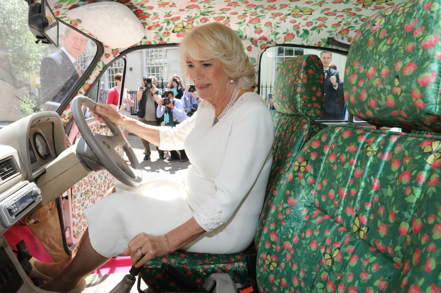 HRH The Duchess of Cornwall inside an Hindustan Ambassdor called 'Pink my Ride' designed by Manish Manish Malhotra